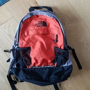 North Face orange & grey backpack